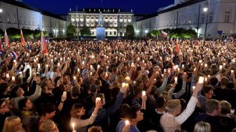 Protesters raise candles during a protest on July 18, 2017 in front of the presidential palace in Warsaw, as they urge the Polish President to reject a bill changing the judiciary system. Polish President Andrzej Duda on July 18 made a surprise compromise bid over controversial court reforms, as thousands of protesters took to the streets.  / AFP PHOTO / ADAM CHELSTOWSKI        (Photo credit should read ADAM CHELSTOWSKI/AFP/Getty Images)