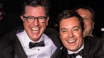 LLOS ANGELES, CA - AUGUST 25: 66th ANNUAL PRIMETIME EMMY AWARDS -- Pictured: (l-r) Comedians Stephen Colbert and Jimmy Fallon pose backstage during the 66th Annual Primetime Emmy Awards held at the Nokia Theater on August 25, 2014. (Photo by Christopher Polk/NBC/NBC via Getty Images)
