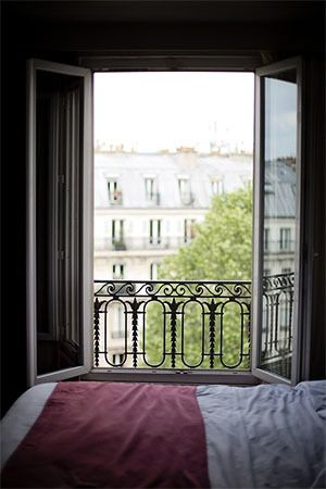 On hot summer days, large windows remain open in Paris instead of running an air conditioner