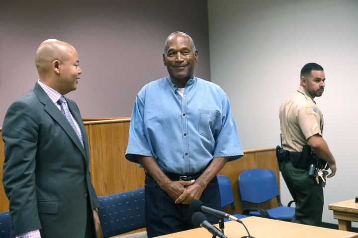 O.J. Simpson looks over at the Nevada Board of Parole Commissioners during his parole hearing on Thursday.