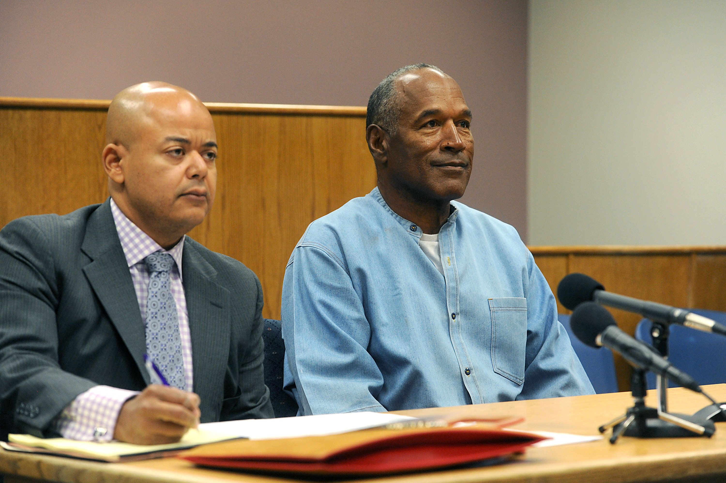 Pool via Getty Images O.J. Simpson sits with his lawyer during his parole hearing on Thursday