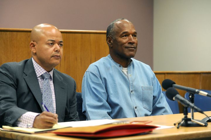 O.J. Simpson sits with his lawyer during his parole hearing on Thursday.