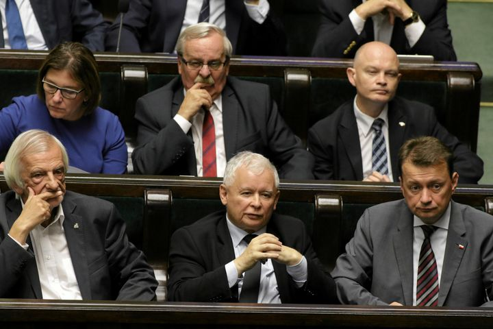 Leader of Law and Justice (PiS) party, Jaroslaw Kaczynski, center, attends a debate before a vote on the bill calling fo