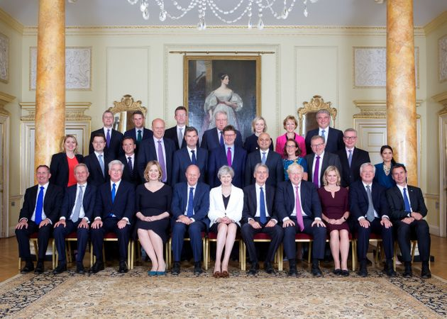 Theresa May and her Cabinet pose for their photo this