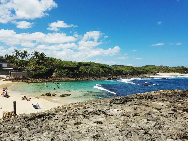"Puerto Rico boasts <a href=""http://www.huffingtonpost.com/entry/puerto-rico_us_593ecd3fe4b02402687bb936"">270 miles of Caribbean beach</a>."
