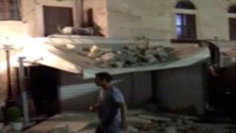 A man walks past a building damaged by a quake in Kos, Greece, July 21, 2017 in this still image taken from video uploaded on social media.  Mandatory credit MUST COURTESY Osman Turanli/Social Media/Handout via Reuters