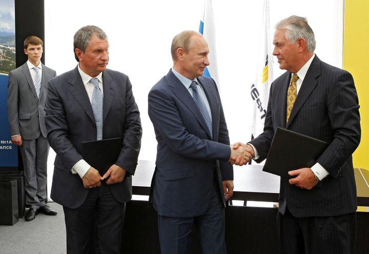 Russia's President Vladimir Putin, Rosneft Chief Executive Igor Sechin and Exxon Mobil Chief Executive Rex Tillerson take par