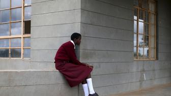 A student awaits for the start of a social event advocating against harmful practices such as Female Genital Mutilation (FGM) at the Imbirikani Girls High School in Imbirikani, Kenya, April 21, 2016. REUTERS/Siegfried Modola