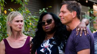 Valerie Castile, the mother of Philando Castile, embraces Don Damond, the fiance of Justine Damond, outside his home on July 20, 2017 in Minneapolis, Minnesota. Several days of demonstrations have occurred after the death of Justine Damond, who was killed late Saturday by a police officer responding to her emergency call about an incident near her home in Minneapolis, Minnesota. / AFP PHOTO / STEPHEN MATUREN        (Photo credit should read STEPHEN MATUREN/AFP/Getty Images)