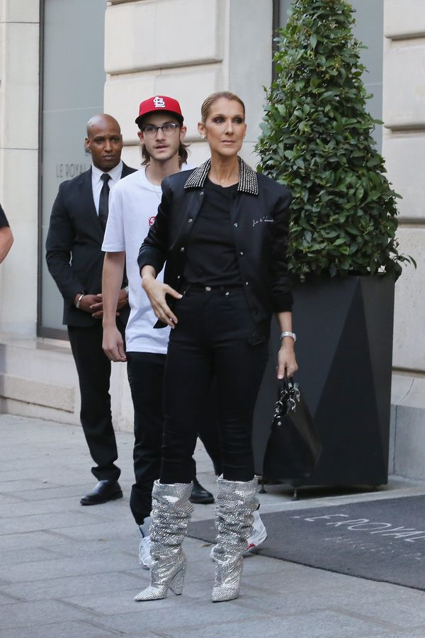 Wearing a YSL jacket, pants and boots and Dior bag on July 7 in Paris.