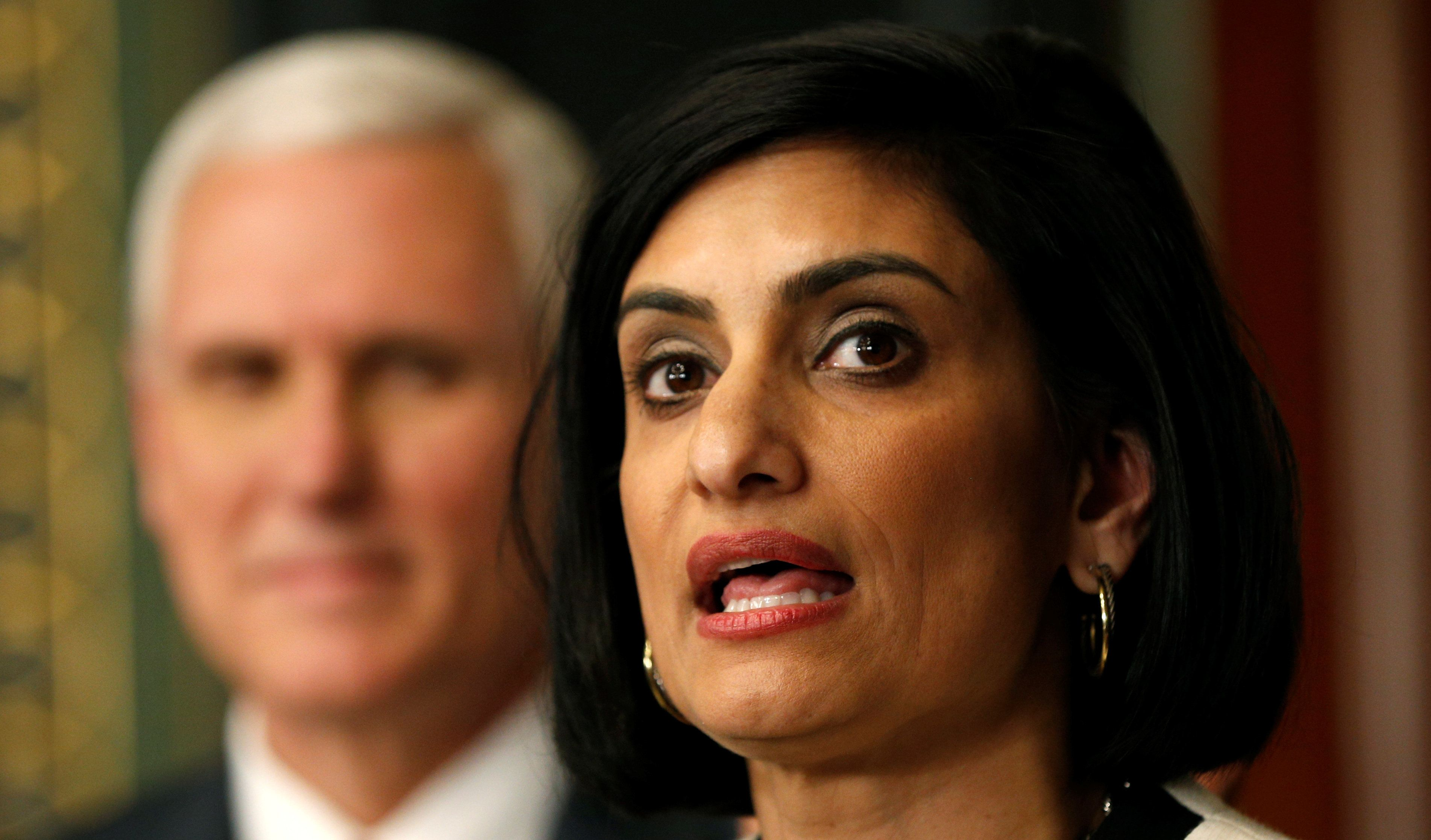 Administrator of the Centers for Medicare and Medicaid Services Seema Verma speaks after being sworn in by U.S. Vice President Mike Pence (L) in Washington, U.S., March 14, 2017.  REUTERS/Kevin Lamarque