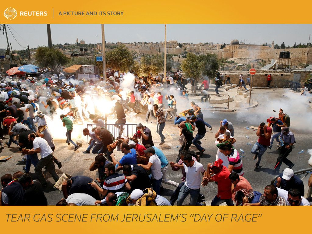"When Muslim elders called for a ""Day of Rage"" on Friday to protest at new Israeli security measures at Jerusalem's holiest site, photographer Ammar Awad knew where he had to be. A native of Jerusalem who has covered the city for Reuters for 17 years, Awad headed to Ras al-Amud, directly across the valley from the Old City, from where the Aqsa Mosque and the golden Dome of the Rock stand out in the near distance. Knowing there were likely to be clashes between Israeli security forces and Palestinian worshippers, and that Muslims intended to pray in the street outside, he climbed up to the roof of a nearby mosque to gain a higher vantage point. ""I know all these areas and the people know me, so it helps,"" said Awad, 36, explaining how he managed to gain access to the mosque, which was shut by the imam to ensure that the faithful held their prayers outside. ""I was on the roof and took lots of pictures of the men praying in the street, with the Old City and the Dome of the Rock in the background,"" he explained. ""After they finished praying, they started shouting 'Allah wa-Akbar' and some were chanting ""I will sacrifice myself for al Aqsa"" in Arabic. The Israeli police started to explode sound bombs to disperse the crowd. ""I was going to come down, but I decided to stay and see what more pictures I could get."" As the sound bombs erupted, many of those who had been praying started to run. Others were still completing their prayers as the scene turned chaotic. Awad fired off 20 frames as a tear gas canister was unleashed on the crowd. The light from the blast lit the scene, highlighting the colours as scores of men cowered from the bang. ""I was lucky to get the picture,"" he said. ""As soon as I saw it, I knew it was the picture of the day. The men were finishing prayers, there's al Aqsa and the Old City in the background - it told the whole story."" REUTERS/Ammar Awad   SEARCH ""AWAD GAS"" FOR THIS STORY. SEARCH ""WIDER IMAGE"" FOR ALL STORIES.  TPX IMAGES OF THE DAY"