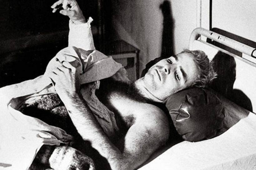 John McCain lies in a hospital bed in Hanoi, North Vietnam, after being taken prisoner of war. (Francois Chalais)