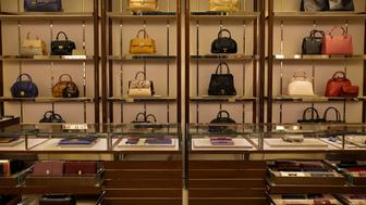 Handbags sit on display for sale inside the Salvatore Ferragamo SpA store at the Village Mall in Rio de Janeiro, Brazil, on Wednesday, Aug. 12, 2015. Cartier and Louis Vuitton, those global symbols of opulence, suddenly look like bargains in one of the world's economic trouble spots: Brazil. Photographer: Nadia Sussman/Bloomberg via Getty Images