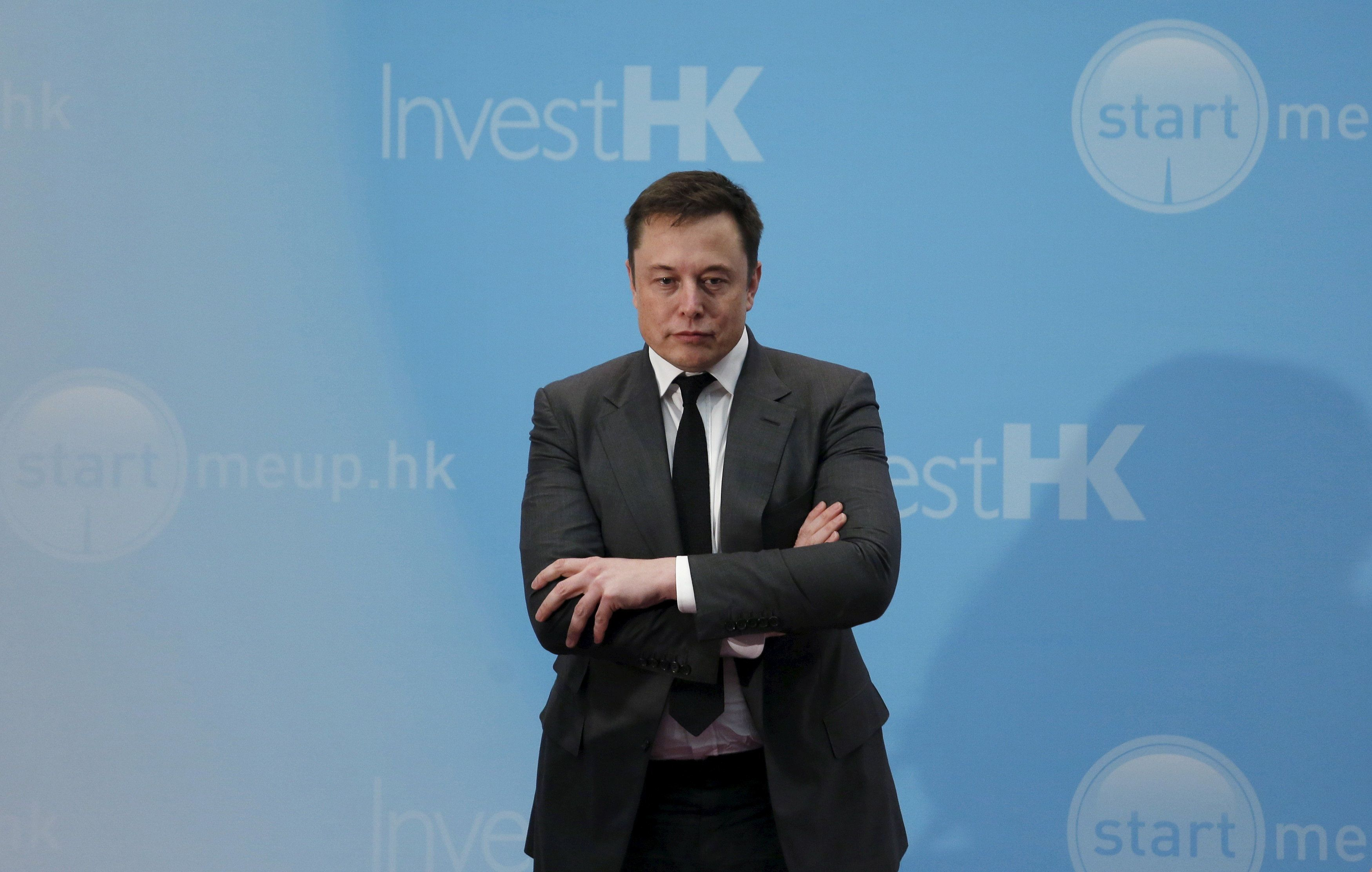 Tesla Chief Executive Elon Musk stands on the podium as he attends a forum on startups in Hong Kong, China January 26, 2016.      REUTERS/Bobby Yip/File Photo