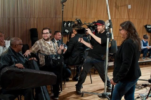 Rebecca Rose, Aruban screenwriter and producer in in New York with Aruban musicians while recording their national anthem wit