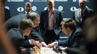 Woody Harrelson watches the opening moves of the world chess championship in New York