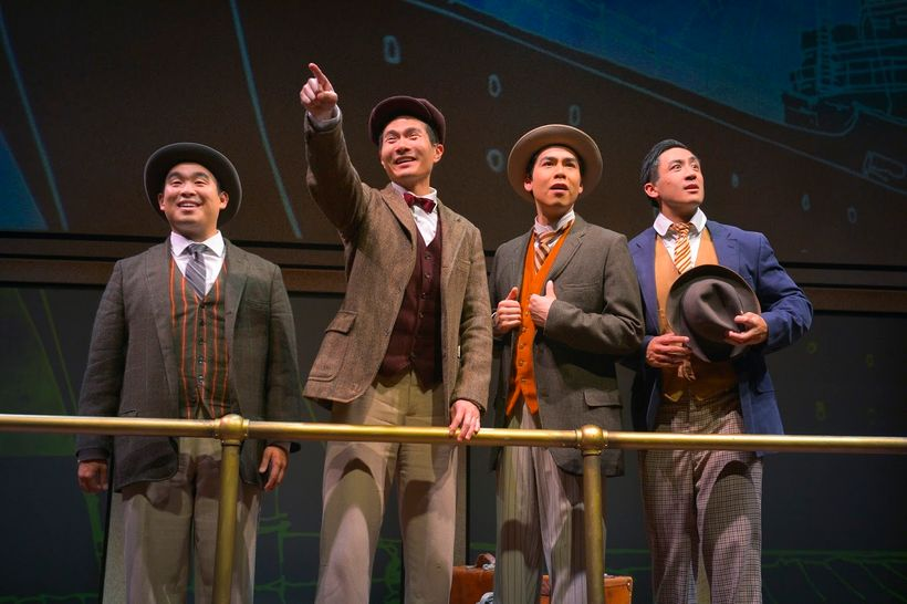 Phil Wong (Frank), James Seol (Henry), Sean Fenton (Fred), and Hansel Tan (Charlie) in a scene from <strong><em>The Four Immi