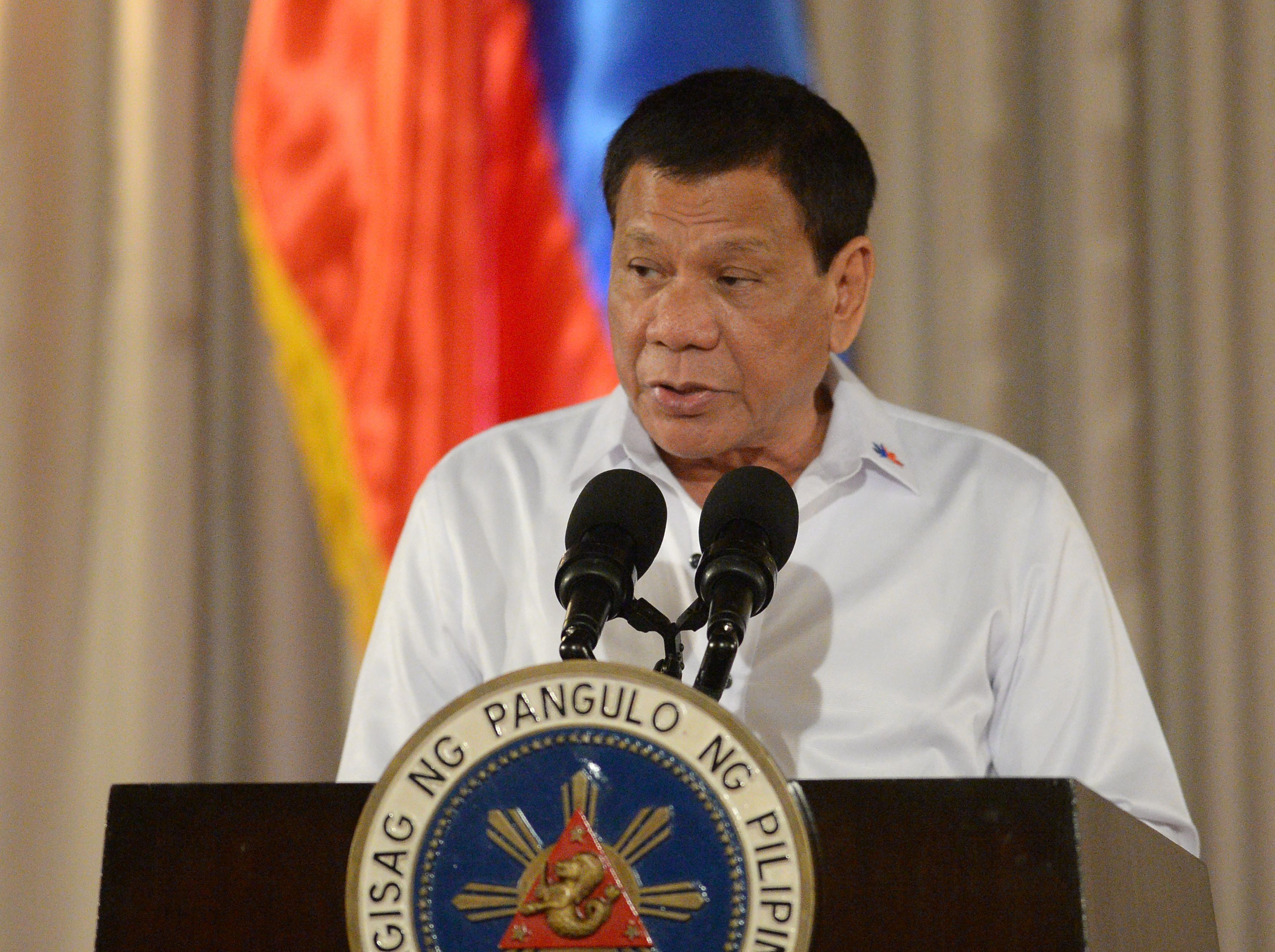 Philippine President Rodrigo Duterte delivers a speech during a ceremony for a proposed draft of the Bangsamoro Basic Law (BBL) at the Malacanang Palace in Manila on July 17, 2017. Duterte offered 'genuine autonomy' to the Philippines' Muslim minority on July 17 to help him defeat Islamist militants who seized a southern city in the gravest challenge to his year-old rule. / AFP PHOTO / TED ALJIBE        (Photo credit should read TED ALJIBE/AFP/Getty Images)
