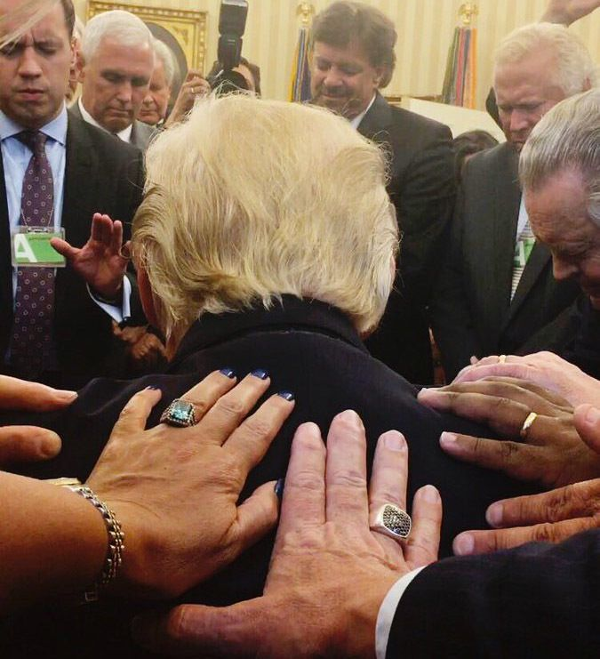 "Christian ministers ""lay hands on"" and pray for Donald Trump last week at the White House"