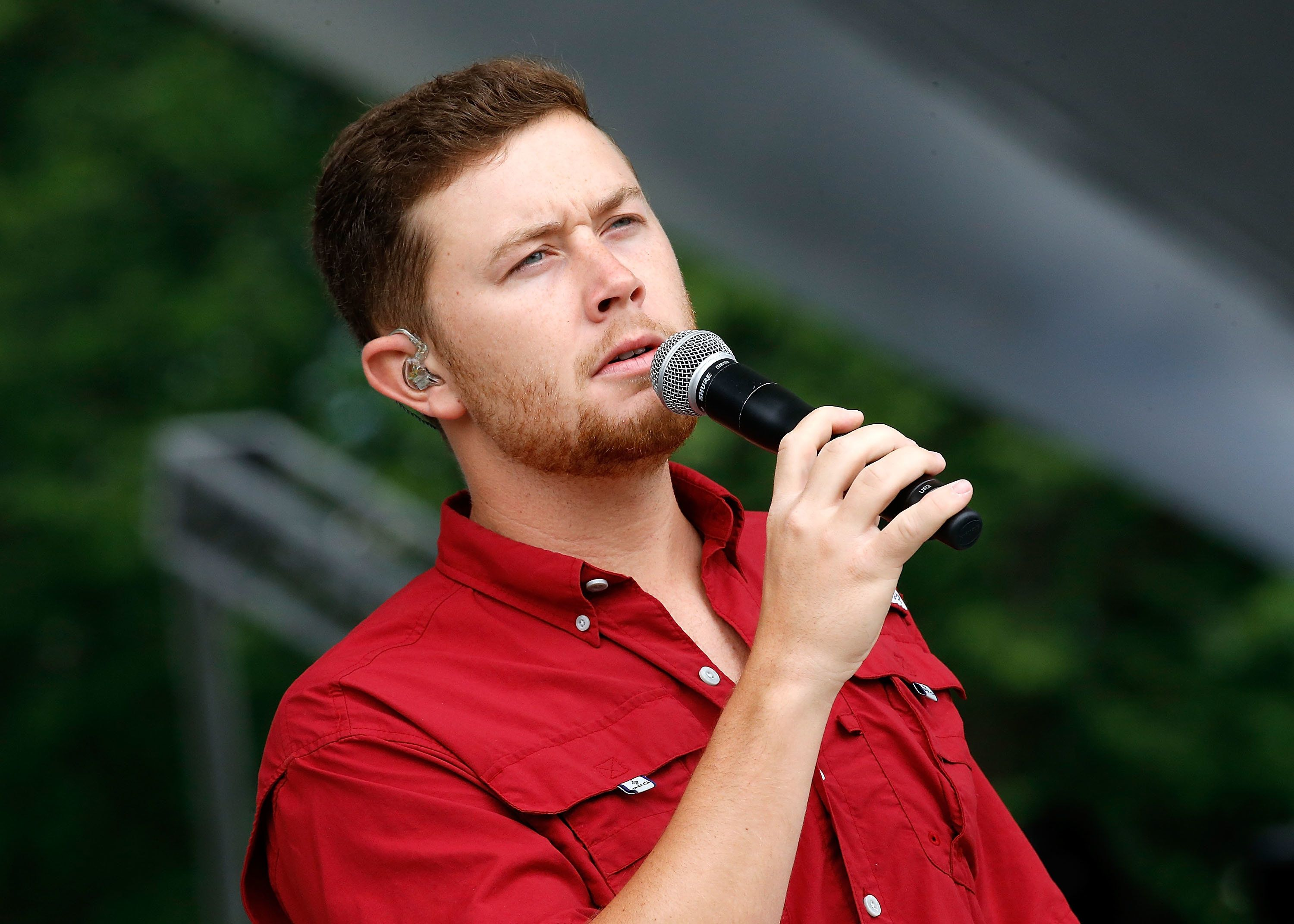 WASHINGTON, DC - MAY 27:  Country music artist Scotty McCreery rehearses for PBS' 2017 National Memorial Day Concert - Rehearsals at U.S. Capitol, West Lawn on May 27, 2017 in Washington, DC.  (Photo by Paul Morigi/Getty Images for Capital Concerts)