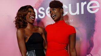 """Creator, executive producer and cast member Issa Rae (R) poses with co-star Yvonne Orji at the premiere for the television series """"Insecure"""" in Los Angeles, California, U.S., October 6, 2016.   REUTERS/Mario Anzuoni"""