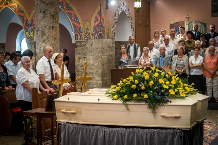 The late couple's daughter, Marcelline Udry, seen third from left, attends her parents' funeral ceremony in Saviese, Switzerl