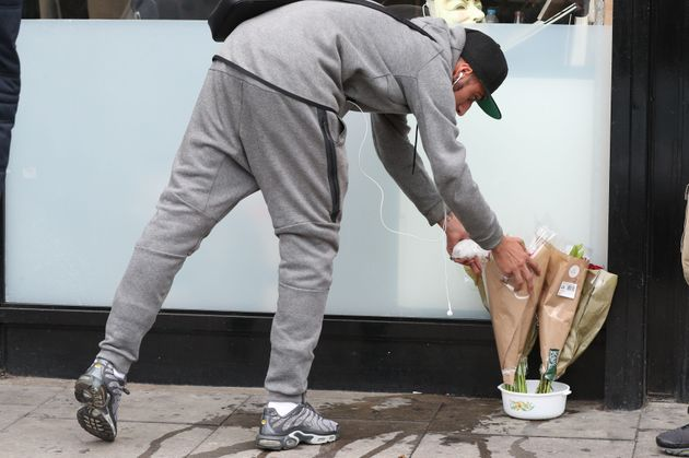 People lay flowers outside a shop in Kingsland Road, east London. The police watchdog has launched an...