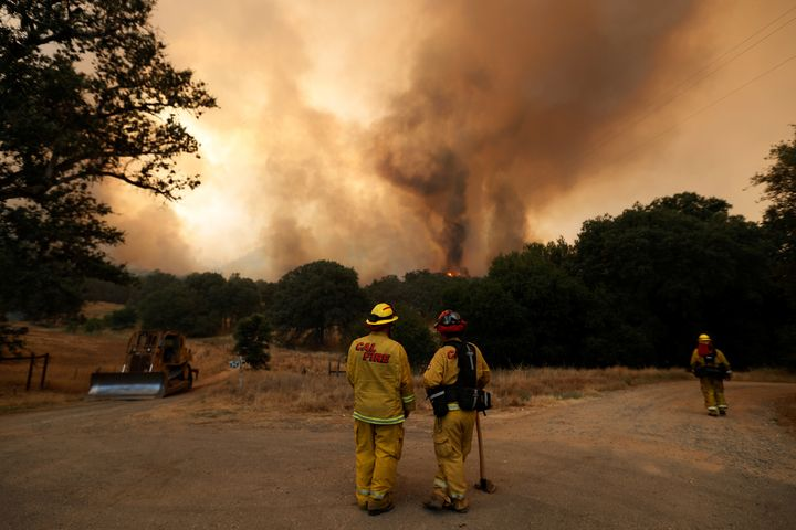 CalFire firefighters monitor flames from the Detwiler fire on July 19.