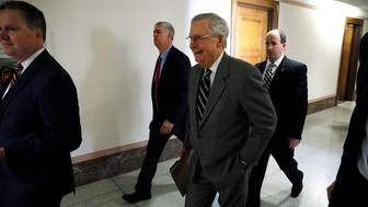 U.S. Senate Majority Leader Mitch McConnell (R-KY) (C) walks to a hearing on Capitol Hill in Washington, U.S. July 20, 2017.  REUTERS/Jonathan Ernst
