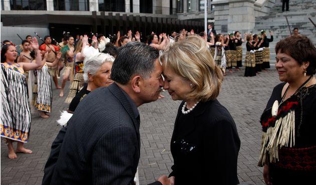 Former US Secretary of State Hillary Clinton hongis with Maori elder Lewis Moeau in