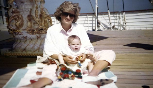Princess Diana playing with Prince Harry aboard the Royal Yacht Britannia in a photograph taken by Prince