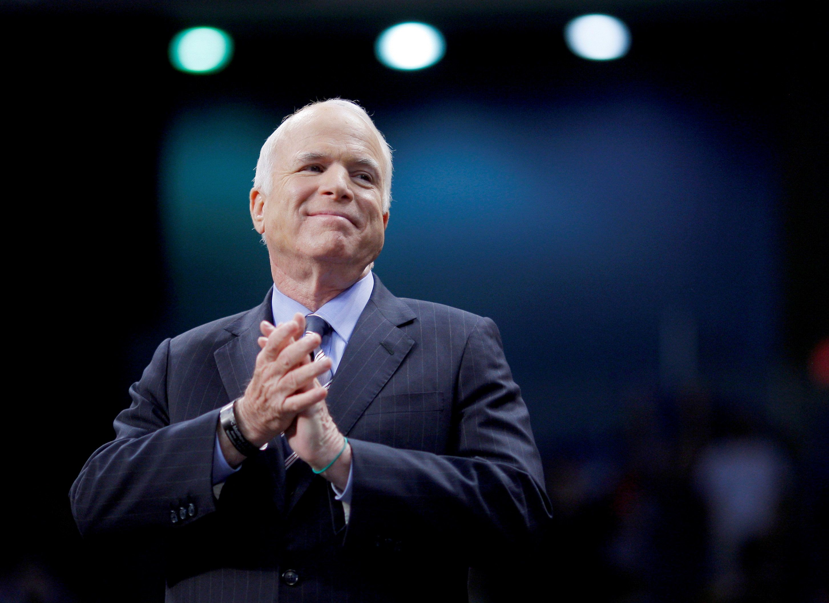 FILE PHOTO- U.S. Republican presidential nominee Senator John McCain (R-AZ) listens as he is introduced at a campaign rally in Fayetteville, North Carolina, U.S. on October 28, 2008.   REUTERS/Brian Snyder/File Photo