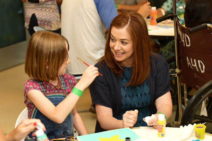 Hannigan and her daughter, Satyana, spent time with kids at LAC+USC Medical Center with Starlight Children's Foundation.
