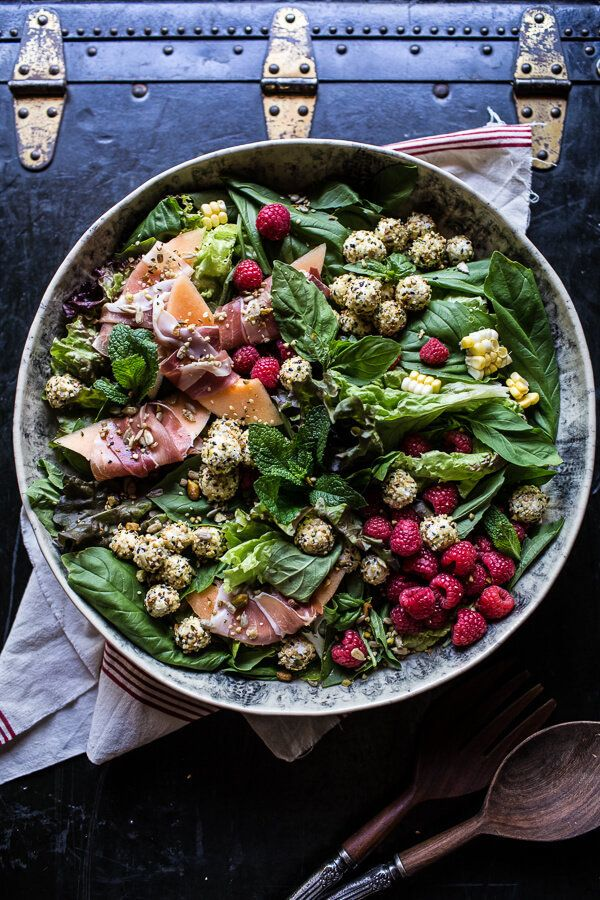 """<strong>Get the <a href=""""https://www.halfbakedharvest.com/fresh-basil-salad-with-prosciutto-wrapped-melon-and-toasted-seed-ro"""