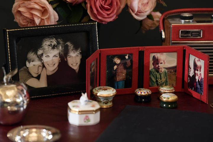 Photos of Princes William and Harry sit atop the desk Princess Diana used at Kensington Palace.