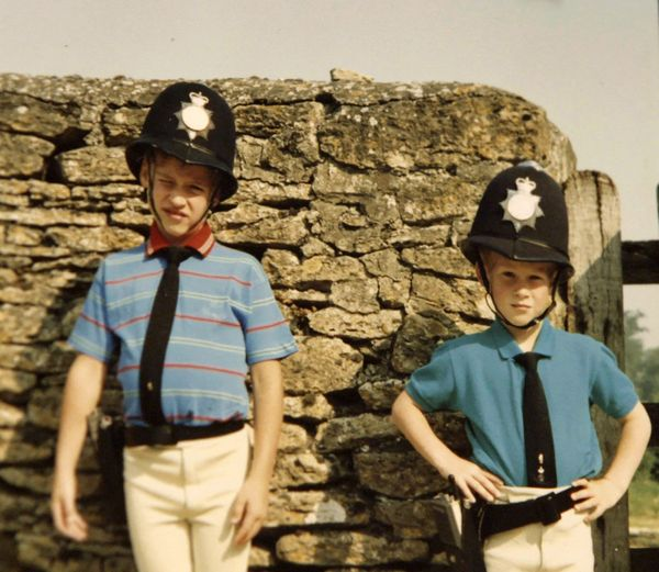 Prince William and Prince Harry pose in borrowed police outfits.
