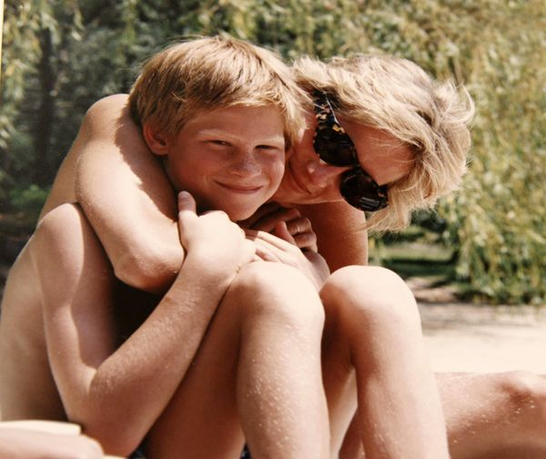Princess Diana poses for a photo with Prince Harry on holiday.