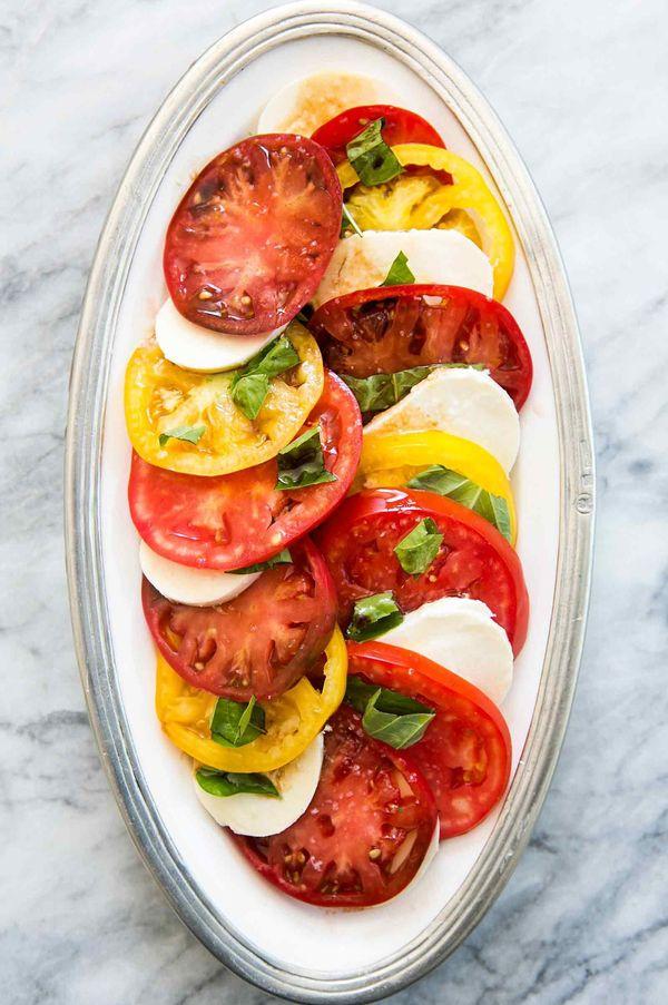 "<strong>Get the <a href=""http://www.simplyrecipes.com/recipes/heirloom_tomato_basil_mozzarella_salad/"" target=""_blank"">Heirlo"