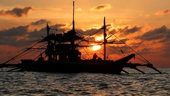 A Philippine boat fishes during sunset at the disputed Scarborough Shoal April 5, 2017. Picture taken April 5, 2017 REUTERS/Erik De Castro