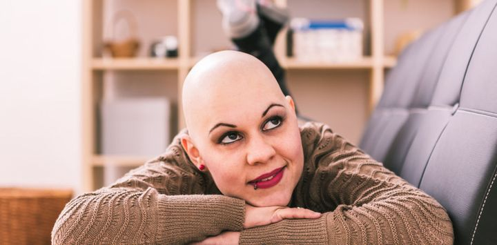 <p>A young breast-cancer patient in her home. </p>