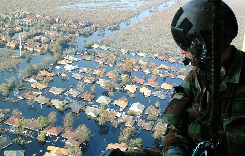 Tech. Sgt. Keith Berry looks down into New Orleans' flooded streets searching for survivors.