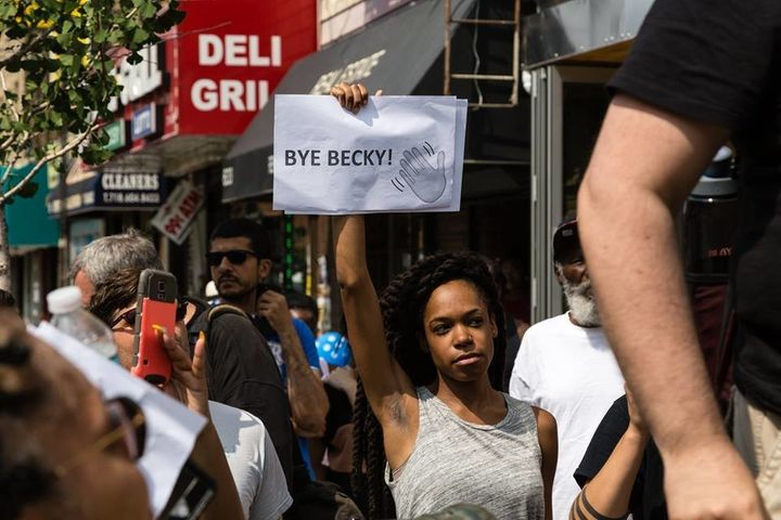 "Organizer Justine Stephens holds up a sign that reads ""Bye, Becky!"""