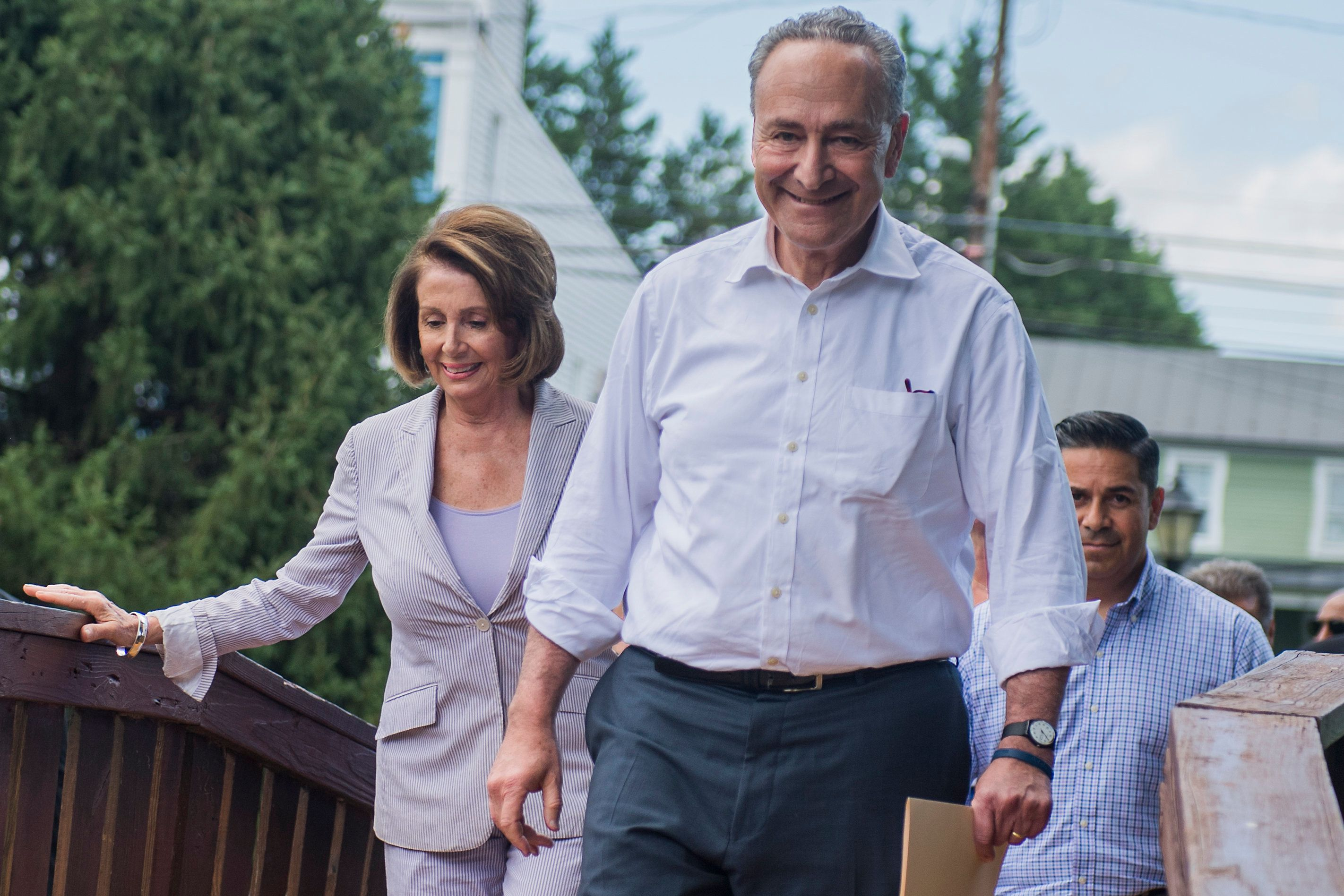 UNITED STATES - JULY 24: From left, House Minority Leader Nancy Pelosi, D-Calif., Senate Minority Leader Charles Schumer, D-N.Y., and and Rep. Ben Ray Lujan, D-N.M., arrive for a rally with House and Senate Democrats to announce 'A Better Deal' economic agenda in Berryville, Va., on July 24, 2017. The plan aims to increase wages and lower expenses for Americans. (Photo By Tom Williams/CQ Roll Call)