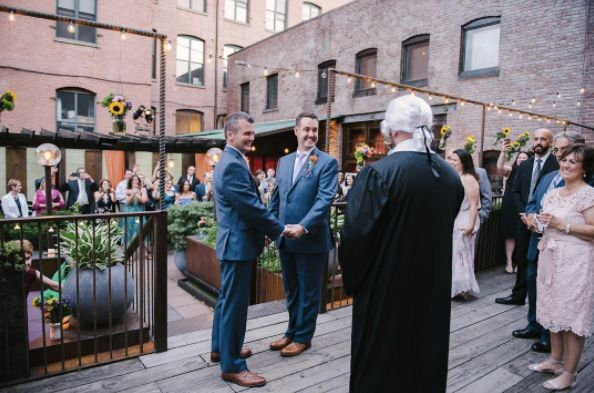 """Mark and Steven surprised their guests with an unannounced ceremony where the officiant was dressed up like a judge! The cer"