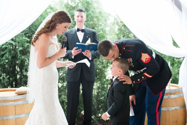 The newlyweds are both on active duty -- the bride is a senior airman in the Air Force and the groom is a sergeant in the Marines.