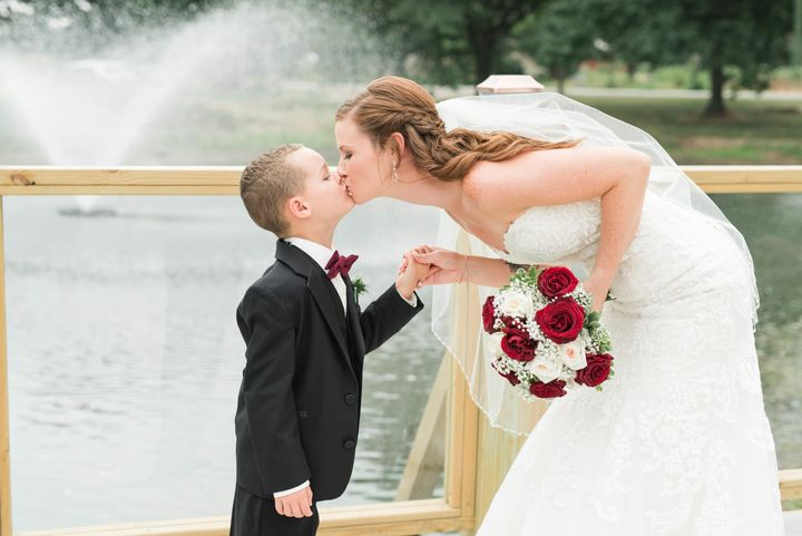 Such a sweet shot of the bride and her stepson.