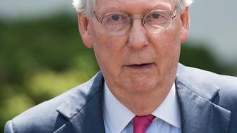 US Senate Majority Leader Mitch McConnell, Republican of Kentucky, speaks to the media following a meeting with Republican Senators and US President Donald Trump to discuss the health care bill at the White House in Washington, DC, July 19, 2017. / AFP PHOTO / SAUL LOEB        (Photo credit should read SAUL LOEB/AFP/Getty Images)
