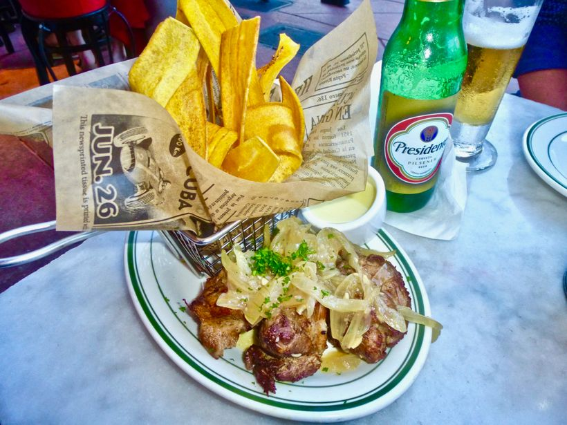Start your meal with the succulent Masitas de Puerco  and a Presidente beer at the Havana 1957 restaurant.