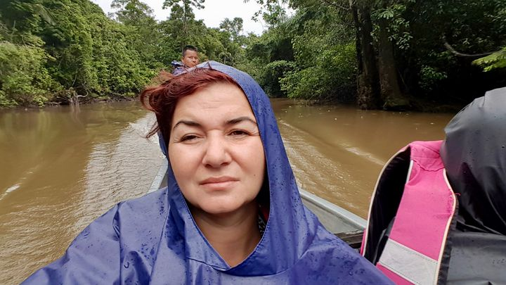<p>Having a FML moment under the strong rain, during a 2 hours long boat ride, in Amazonian Rain Forest.</p>